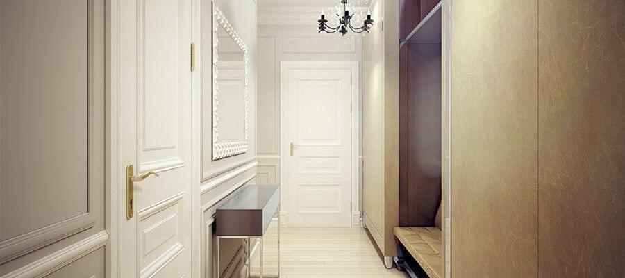 Una integración inteligente crea orden – aquí: un armario y un closet con una pequeña banca